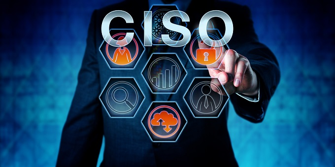 Male corporate executive touching CISO on an interactive virtual control monitor. Business management occupation metaphor and information technology concept for Chief Information Security Officer.